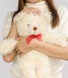Asian teen holding a  bear doll. Stock Photo