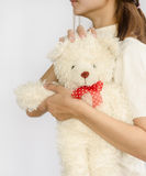 Asian teen holding a  bear doll. Stock Photography