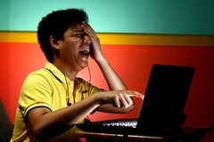 Asian Teen laughing and Working on a Laptop Computer Stock Photos