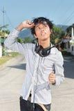 Asian teen looking at sun Stock Photo
