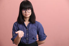 Asian teen palm up Royalty Free Stock Image