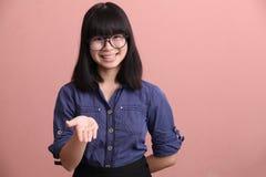 Asian teen palm up Stock Image