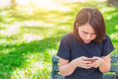 Asian teen using smartphone royalty free stock photo