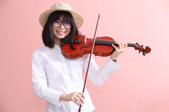 Asian teen with violin glasses hat smile Stock Photo