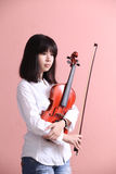 Asian teen with violin Stock Photo