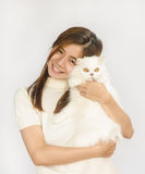 Asian teen and a  white cat Royalty Free Stock Photos
