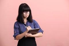 Asian teen writing tablet royalty free stock photos