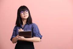 Asian teen writing tablet stock photos