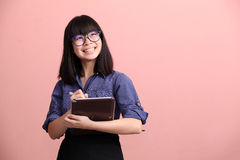 Asian teen writing tablet Royalty Free Stock Photo