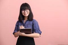 Asian teen writing tablet stock photography