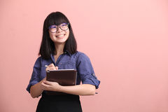 Asian teen writing tablet royalty free stock photography