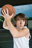 Asian teenage boy with basketball Stock Photography