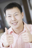 Asian teenage boy giving thumbs up Royalty Free Stock Photo