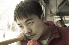 Asian teenage boy staring. Asian teenage boy is thinking deeply royalty free stock image