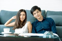 Asian teenage couple look at the camera on table have a planning stock photo