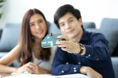 Asian teenage couple is planning to build his future house with stock photography