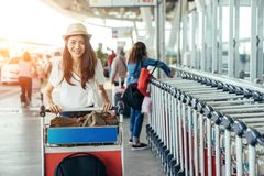 Asian teenage girl is carrying the bag. At the international airport to travel on weekends. Teenage girl in airport stock photo