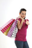 Asian teenage girl  carrying shopping bags Royalty Free Stock Image
