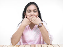 Asian teenage girl covering her mouth Royalty Free Stock Image