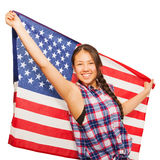 Asian teenage girl holds American flag behind her Royalty Free Stock Image