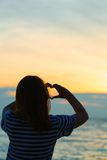 Asian Teenage girl making heart shape in sky Royalty Free Stock Photo