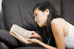Asian teenage girl reading book stock images
