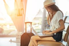 Asian teenage girl is using a laptop to check email or social network stock photos