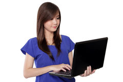 Asian teenage girl working on laptop stock photos