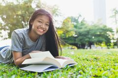 Asian teenage girls are smiling after reading books stock images