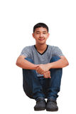 Asian teenager boy. Smiling asian teenager boy sitting, Isolated on white Stock Photos