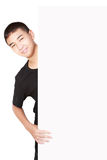 Asian teenager boy behind blank sheet of paper. Isolated on white Stock Photography