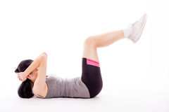Asian teenager doing situps. Asian teenage girl doing situps on white background Stock Photos