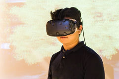 Asian teenager experiencing VR virtual reality entertainment gad Stock Image