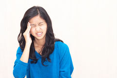 Asian teenager feel headache. This portrait represent illness about headache Royalty Free Stock Photography