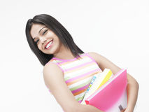 Asian teenager with files Stock Photos