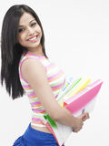Asian teenager with files. Beautiful asian teenager of indian origin with files Royalty Free Stock Image
