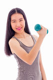 Asian teenager lifting dumbbell Royalty Free Stock Images