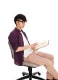 Asian teenager reading book. Stock Photos