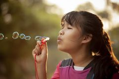 Asian teenager relaxing with soup bubble against beautiful sun light. Asian teenager  relaxing with soup bubble against beautiful sun light royalty free stock image