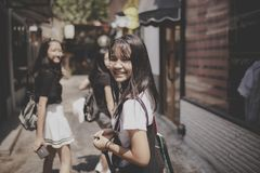 Asian teenager smiling face happiness emotion walking in citylife street stock photos