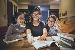 Asian teenager student and woman teacher toothy smiling face in. Asian teenager student and women teacher toothy smiling face in modern class room royalty free stock photography