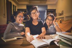 Asian teenager student and woman teacher toothy smiling face in. Asian teenager student and women teacher toothy smiling face in modern class room royalty free stock photos