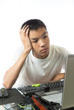 Asian teenager using computer with boring face Stock Photos