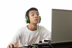Asian teenager using computer and listen to music Stock Images