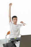 Asian teenager using computer with victory gesture Stock Images