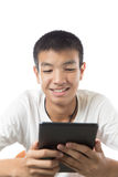 Asian teenager using his tablet with smile Stock Image