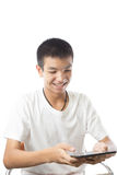 Asian teenager using his tablet with smile Stock Photography
