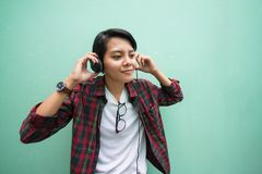 Asian. Teens are listening to music at close range with green vintage tone stock photography