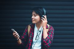 Asian. Teens are listening to music at close range with vintage tone. Background royalty free stock images