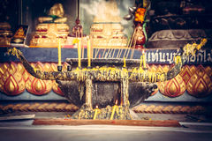 Asian temple with altar and burning candles in Asian culture in retro vintage style Stock Photography